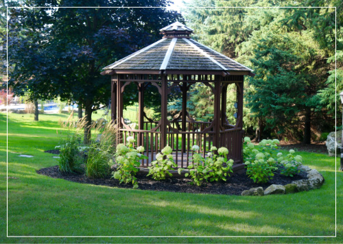 gazebo surrounded by grass