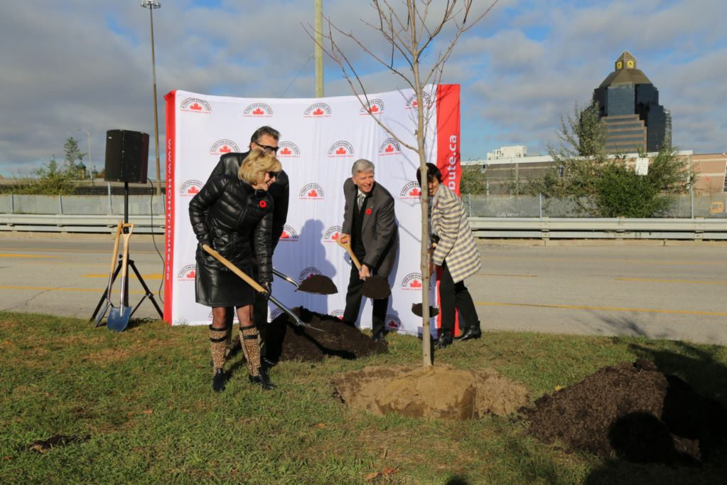 Ceremonially planting the tree